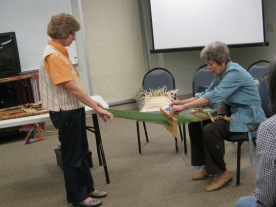 Laurel demonstrates backstrap weaving