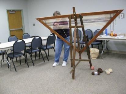 Teresa worked on her triangular loom