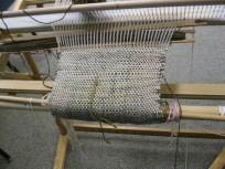 Nancy worked on a scarf on her rigid headle loom