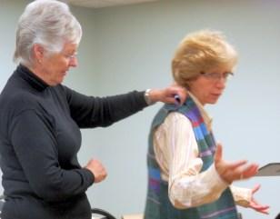 Helen fitting Linda's handwoven vest