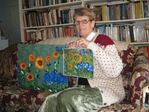 "Anne, inspired by Van Gogh's ""Sunflowers and Irises,"" created this beautiful picture from all sorts of paper, including paper napkins for the irises."
