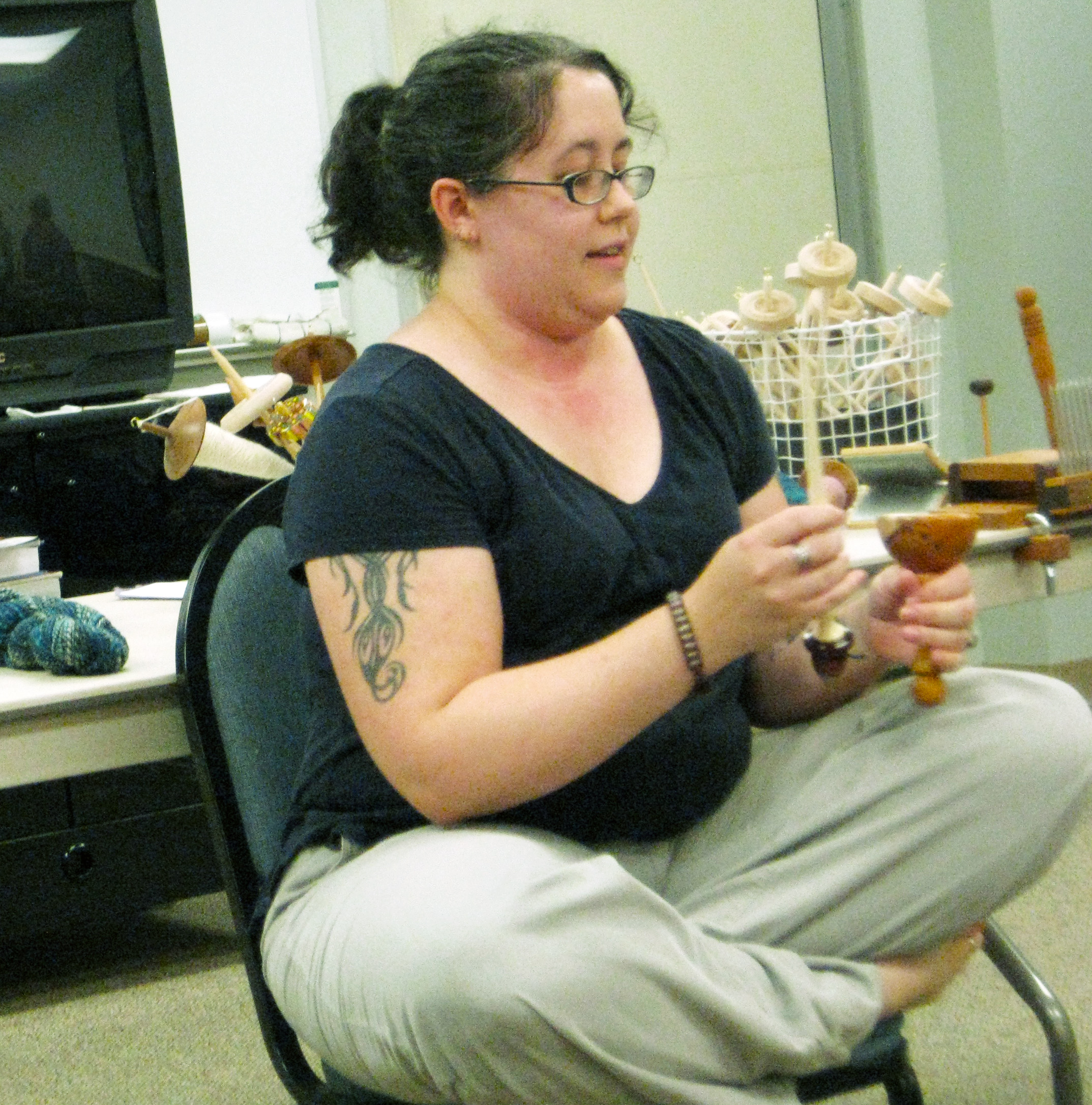 Holly demonstrates using a drop spindle