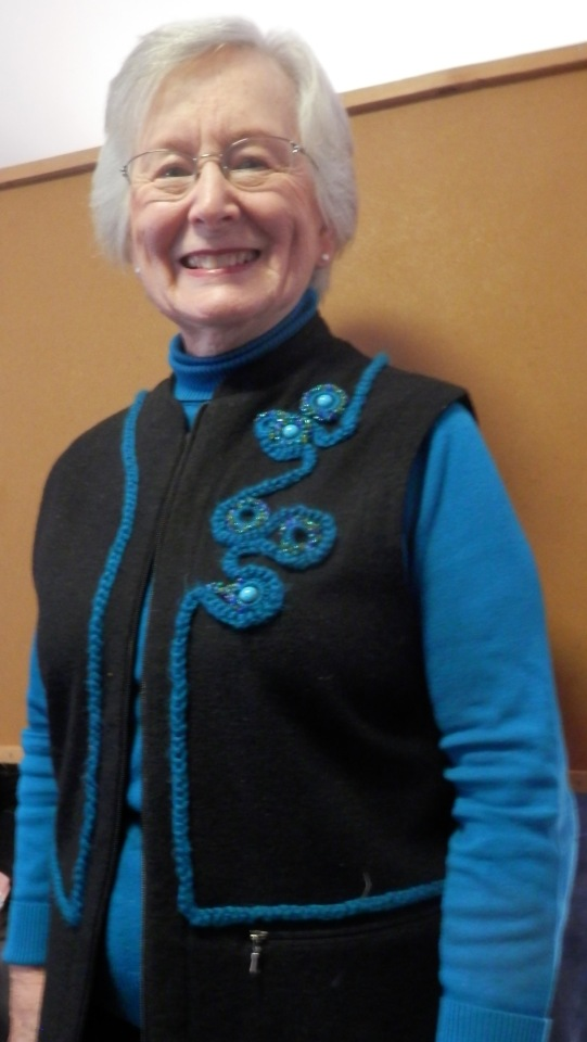 Betty used Anita Luvera Mayer's techniques for cords and beaded circles to change a solid color vest into a stunning accessory.