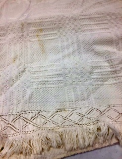 Louella shared her family heirloom! A beautiful hand spun cotton counterpane coverlet in exquisite condition with hand knit fringe on 3 sides. Probably woven around 1865 on the barn loom that she has. Truly magnificent!