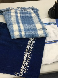 Members' plaid wrap and other woven pieces purchased in Mexico
