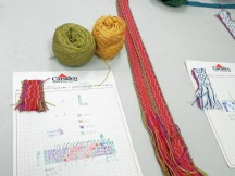 The materials required to weave a band on an Inkle loom using cards