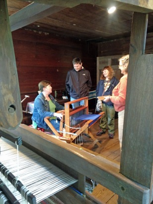 Kate entertains and educates visitors on the ins and outs of weaving