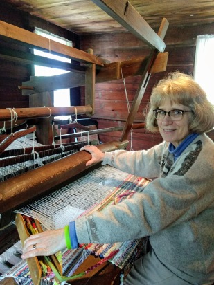 Linda weaving on the historic loom in the Bryant House during Clenny Creek Day