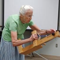 Barbara demonstrates how string heddles work