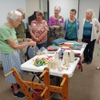 Barbara shows Inkle loom samples
