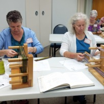Kathy and Laura working with Inkle looms