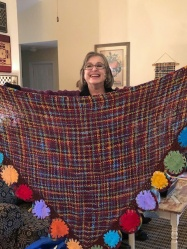 Teresa created a beautiful triangular shawl, decorated with hair-pin lace flowers, to match her colorful creation.