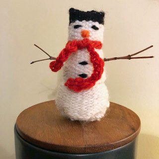 Deborah's snowman with stick arms