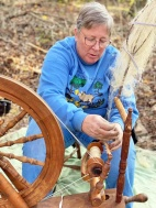 A friend of the Forge demonstrates spinning with flax
