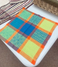 Sharon wove napkins with a different Huck pattern in each square
